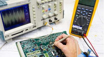 Asian engineer with eyeglasses working with microscope. DKM offers NetSuite ERP solutions for the Electronics industry.